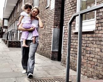 mother and daughter on housing estate